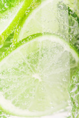 Detox water with lime and mint in glass
