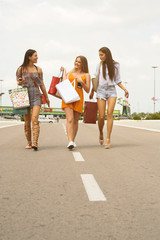 Female young friends doing shopping in the city.