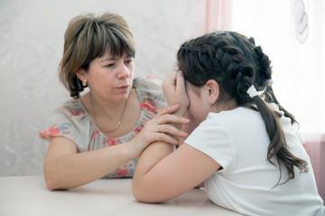 Mom calming  teen  daughter