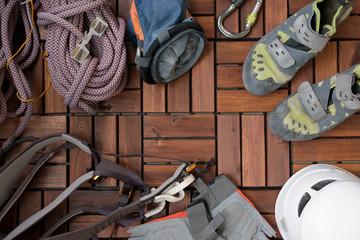 Foto op Aluminium Alpinisme all climbing gear you need on wooden floor.