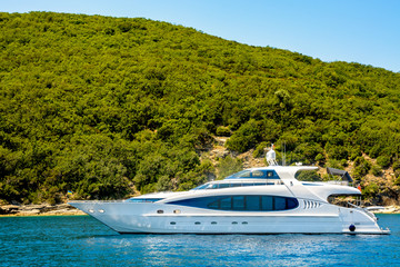 Motor yacht on the background of the coastline of the Adriatic Sea Montenegro.