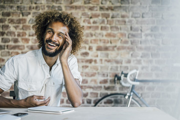 Happy young man at desk