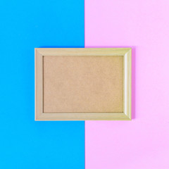 Photo wood frame on colorful paper wall background