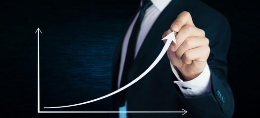 Businessman pressing business chart.