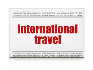 Tourism concept: newspaper headline International Travel