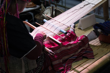old woman weave traditional Thai fabric textile