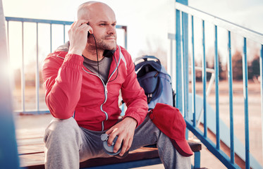 Relaxing after fitness training outdoors. Sport, fitness, workout