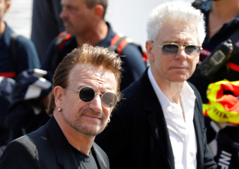 Singer Bono and musician Adam Clayton of Irish band U2 arrive to attend the commemorative ceremony for last year's July 14 fatal truck attack on the Promenade des Anglais in Nice