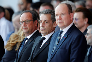 From R-L, Prince Albert II of Monaco, former French presidents Nicolas Sarkozy and Francois Hollande attend the commemorative ceremony for last year's July 14 fatal truck attack on the Promenade des Anglais in Nice