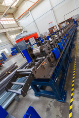 Fototapeta Production line for manufacturing of the engines factory. Factory. Engine factory. New engine factory. Engines on line. Vertical view