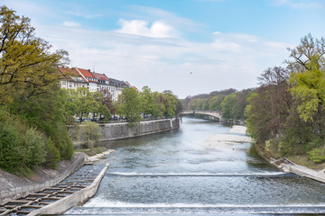 View of building along the Isar river in Munich, Germany. from Maximiliansbrücke or Maximilian bridge.