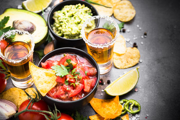 Mexican food party sauce guacamole, salsa, chips and tequila. Latin food.