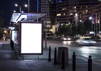 Fototapeta Blank poster on bus stop at night obraz