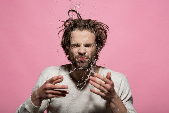 splash of water drops of man washing face in morning
