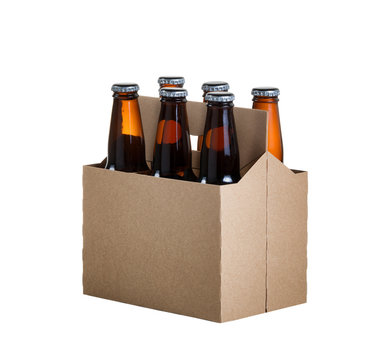Six pack of glass bottled beer in generic brown cardboard carrier isolated on white