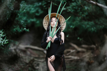 Portrait Vietnamese girl wearing conical hat.