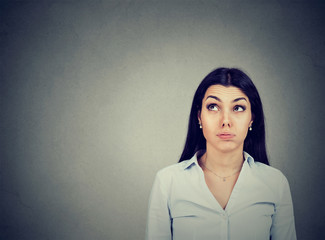 Confused thoughtful woman making up her mind