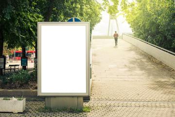 Blank mock up of vertical street poster billboard, daytime
