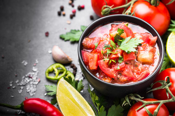 Traditional Latin American mexican salsa  sauce on black stone table