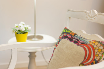 Nightstand with flower vase and Armchair With Pillow