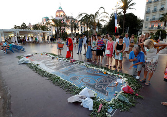 People look at a memorial on the Promenade des Anglais as part of the commemorations of last year's July 14 Bastille Day fatal truck attack in Nice