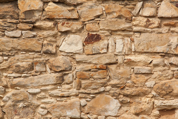 The detail, close up of the sandstone brick wall. The texture of the sandstone. It can be useld as the background.