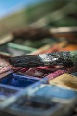 watercolors and paintbrush - art still life