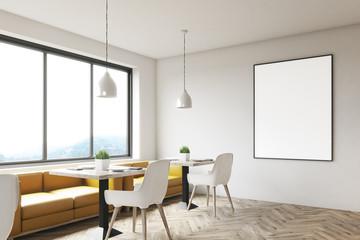 White cafe with a framed poster, corner