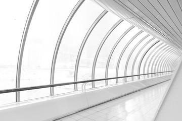 Contemporary symmetric vanishing corridor with bent wall