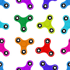 Vector seamless pattern of colorful fidget spinners for decoration, gift wrapping paper and covering on the white background. Concept of stress relieving toys.