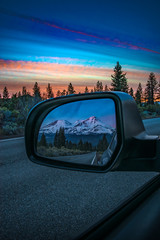 Reflection in rear view mirror of mountain sunset