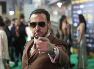 Actor Gulshan Glover poses for a picture on the Green Carpet at the International Indian Film Academy Rocks show at MetLife Stadium in East Rutherford