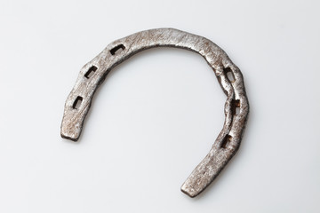 An old horseshoe on a white background