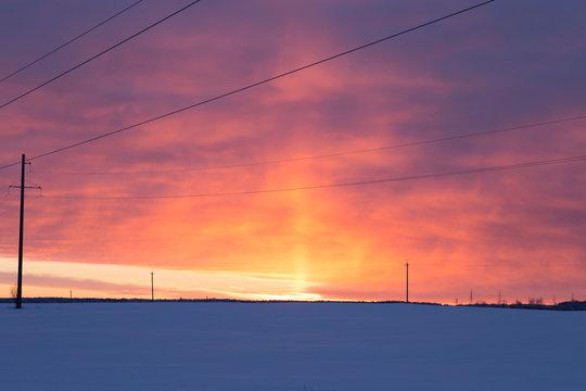 a power line frosty winter sunset