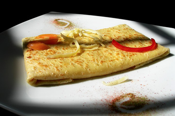 Cheese and Tomato Crepe illuminated by natural light from window