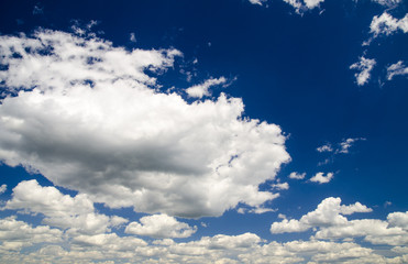 Cute white clouds in the sky background