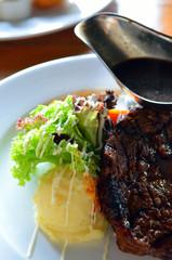Roast steak with gravy sauce..
