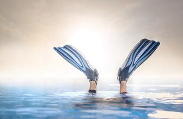 Fins detail of a scuba diver diving