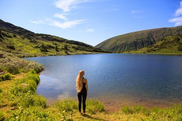 Girl on mountain lake
