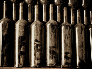 Vintage wine bottles in wine cellar with dust on them