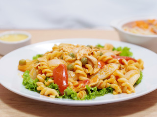 macaroni with tomato sauce on white plate