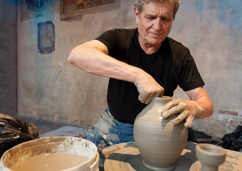 Master of clay at work on the pottery wheel
