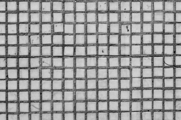 Veneer is made of small white tiles.
