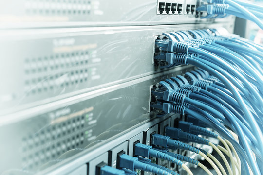 Network cables in switch and firewall in cloud computing data center server rack