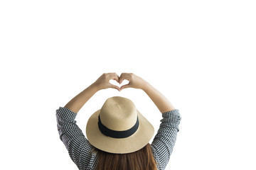 Asian tourist women from the back, making a heart shape with her hands isolated on white background