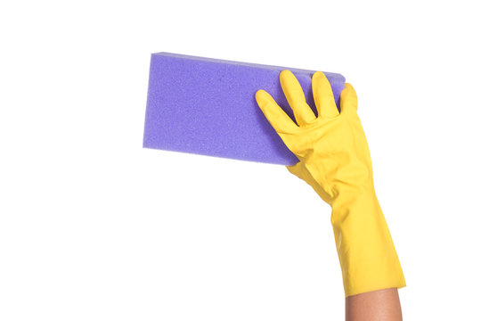 Hand in yellow glove with violet sponge isolated on white background