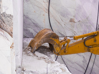 Mechanical shovel in action for marble extraction