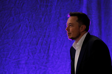Tesla Motors CEO Elon Musk takes the stage to speak at the National Governors Association Summer Meeting in Providence