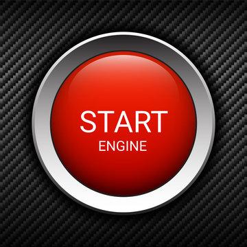 Start engine button on carbon background