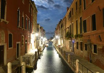 Venetian canal Rio de la Fornace at night in Venice, Italy.